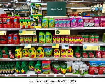 READING, BERKSHIRE - APRIL 7, 2018: Varieties of plant food products on sale at Dobbies Garden Centre in Reading, Berkshire, UK.