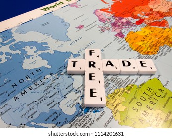 Reading, Berkshire, England - June 13, 2018, representation of free trade, international trade left to its natural course without tariffs, quotas, or other restrictions, on world map background