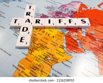 Reading, Berkshire, England - June 29, 2018, representation of trade tariffs imposed by the United States of America on steel and aluminium imports on world map background
