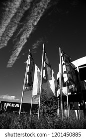 Reading, Berkshire, England - September 24, 2017: monochrome IKEA flags outside store, Scandinavian retail chain selling ready to assemble furniture founded in 1943 by Ingvar Kamprad