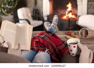 reading book  near fireplaces