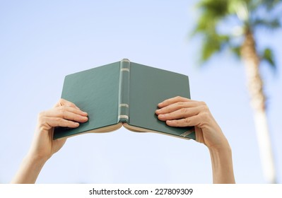 Reading book on nature background
