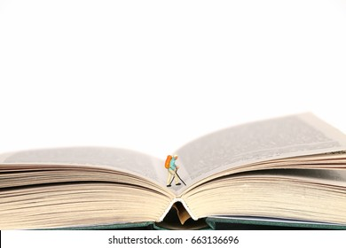 Reading concept. journey into the world of books. Traveler's figure on the pages of books on a white background