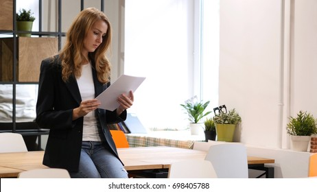 Reading Documents, Businesswoman Sitting on Desk, Paperwork