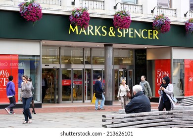 Reading, England - August 28th, 2014: People passing by the Marks and Spencer store in Reading, England. Founded in 1884, M&S has grown from a single market stall into an international retailer.