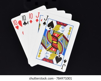 Reading, England - December 28 2017:   Full House hand in poker card game