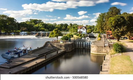 Reading, England, UK - August 29, 2016: The weir and lock on the River Thames at Goring in Berkshire.