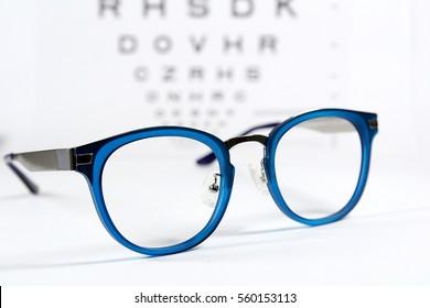 Reading eye glasses with eye chart isolated on white