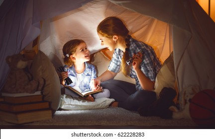 Bedtime story images stock photos vectors shutterstock reading and family games in childrens tent mother and child daughter with book and flashlight sciox Gallery