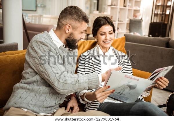 Reading Furniture Catalog Positive Bright Couple Stock Photo (Edit
