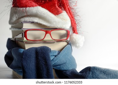 Reading glasses concept with books Santa Claus hat and neckerchief