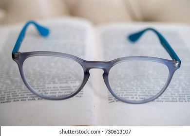 reading glasses isolated on a open old book