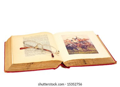 Reading glasses on antique book
