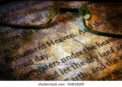 Reading  glasses on bible grunge concept