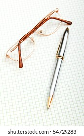 Reading glasses on the black page