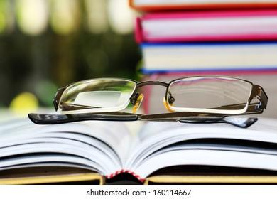 Reading glasses on books