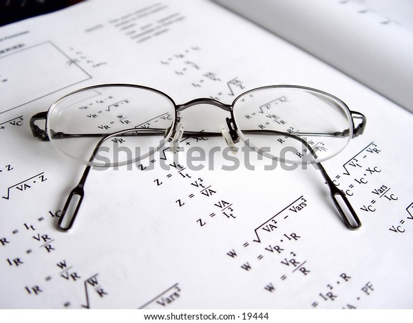 Reading glasses on a business book