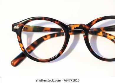 Reading glasses on a white background macro close up shot