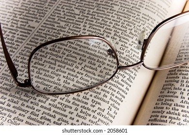 Reading glasses over a book