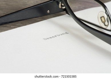Reading glasses and sheet of paper with the German word for imprint
