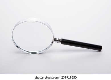 A reading glasses(magnifying glass[lens], magnifier) isolated white at the studio.