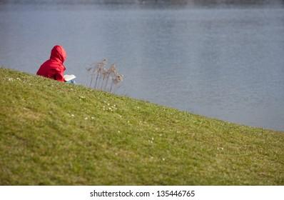reading at lake side