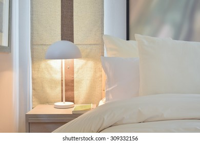 Reading lamp on bedside table
