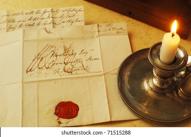 Reading a letter by candle light from 1800's