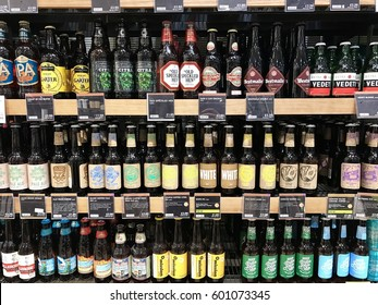 READING - MARCH 12, 2017: Colourful varieties of craft beers, ales and lagers line the shelves of Marks and Spencer (M&S) Simply Food in Lower Earley, Reading, Berkshire, UK.