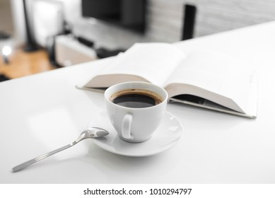 Reading in a morning with a delicious cup of fresh coffee