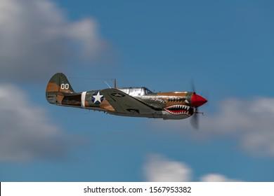 "READING, PA - JUNE 2, 2018: Curtiss P-40M ""WARHAWK"" in flight during World War II reenactment at Mid-Atlantic Air Museum"