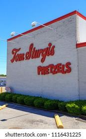 Reading, PA, USA - June 14, 2018: The Sign at Tom Sturgis Pretzels, a commercial pretzel bakery near Shillington, Berks County, PA.