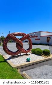 Reading, PA, USA - June 14, 2018: A large pretzel sign at Tom Sturgis Pretzels, a commercial bakery near Shillington, Berks County, PA.