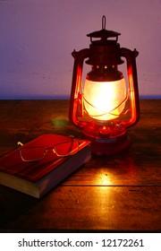 Reading at paraffin lamp light