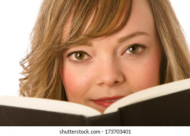 Reading - This is a close up image of a cute young woman enjoying a good book! Shot with a shallow depth of field on a white background.