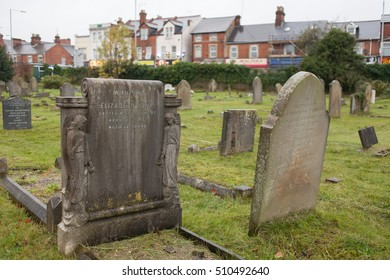 READING, UK - 2016: Tombs of various shapes and sizes on green grass.
