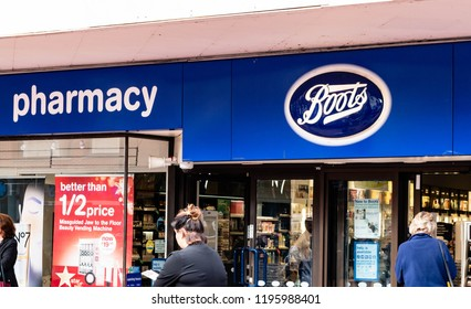 Reading, UK. 5th October 2018. The Chemist  store, central Reading shopping area with pedestrians walking outside shopping.Biggest Pharmacy in UK is Boots.