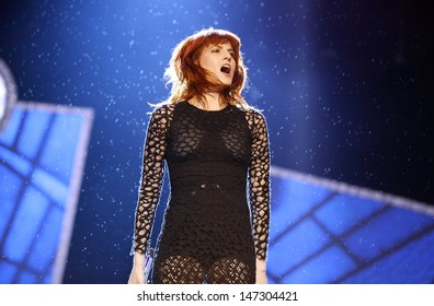 Reading, UK. Florence Welch of  Florence & The Machine performing live during Reading Festival 2012 at Richfield Avenue in Reading.  August 25, 2012.
