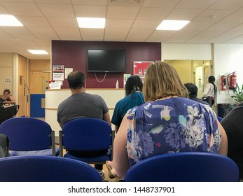 Reading, UK - July 12 2019: People sit and wait in a waiting room for a blood test in a hospital.