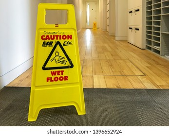 Reading, UK - May 13 209: A sign warns people passing by that the floor is potentially wet and slippery.