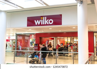 Reading, UK November 30, 2018: Sign above the entrance to a Wilko Hardware store in the town's mall. A local Wilkinson Wilko  Retail logo sign above shop