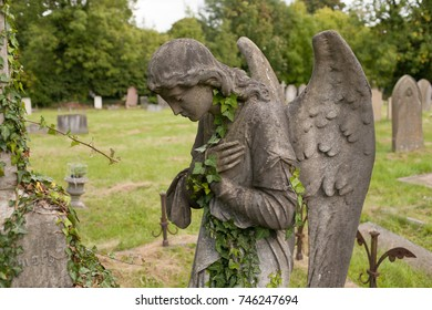 READING, UK - OCTOBER 2017: Statue of angel in Reading Cemetery.