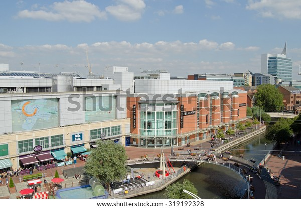 READING, UK - SEPTEMBER 10, 2015:  Aerial view of the River Kennet in the centre off Reading, Berkshire as pedestrians and shoppers enjoy the early afternoon sunshine at the Oracle Shopping Centre.