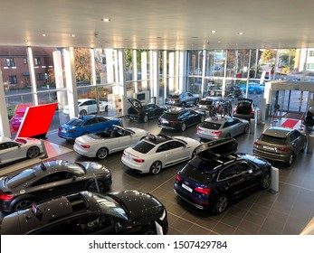 READING, UK - SEPTEMBER 18, 2019: Display cars inside an Audi showroom at a dealership in Reading, Berkshire, UK.
