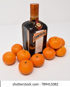 Reading, United Kingdom - December 31 2017:   A Bottle of Cointreau Orange liqueur with some clementine oranges
