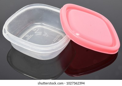 Reading, United Kingdom - February 03 2018:   A small tupperware box with  a pink lid