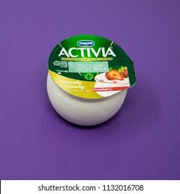Reading, United Kingdom - July 08 2018:   A pot of Danone Activia strawberry flavour yogurt