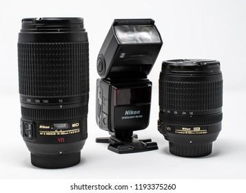 Reading, United Kingdom - September 29 2018:   A Nikon AF-S Nikkor 70-300mm G ED telephoto lens, AF-S Nikkor 18-105mm G ED standard zoom lens and Speedlight SB-600 flash gun