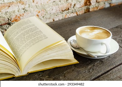 Reading vintage old book and coffee