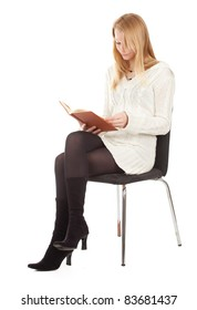 reading young blond hair woman with brown book sitting on chair